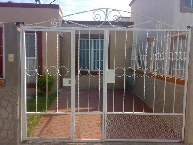 Puertas zaguanes de herreria car interior design for Casas con puertas de madera